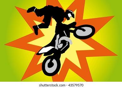 Motocross biker in big jump.