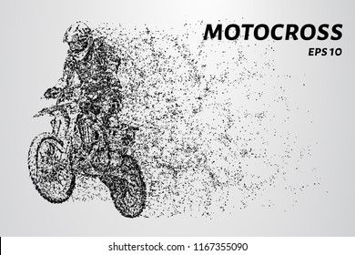 Motocross particles. A motorcyclist performs stunts.