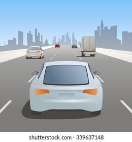 motor vehicles driving on urban highway