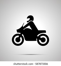Motorcyclist modern simple black icon with shadow