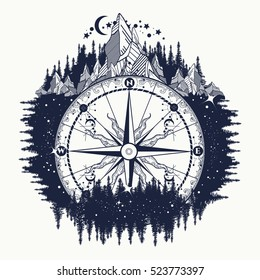 Mountain antique compass and wind rose tattoo art. Adventure, travel, outdoors, symbol. Compass in night forest, t-shirt design