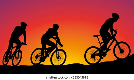mountain bike race - cyclists silhouettes on the background