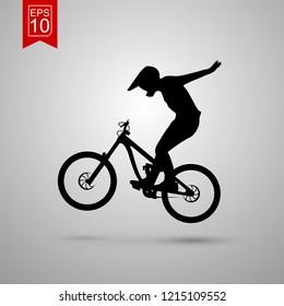 Mountain biker silhoette. mountain Biker doing a tuck no hander. Vector Illustration.
