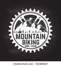 Mountain biking. Vector illustration. Concept for shirt or logo, print, stamp or tee. Vintage typography design with man riding bike and mountain silhouette. Chalk drawing on a blackboard.