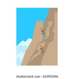 Mountain climbers climbing a peak