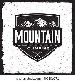 mountain climbing vintage emblem. logotype template with mountains, ice axe. outdoor activity symbol  with ink stamp texture