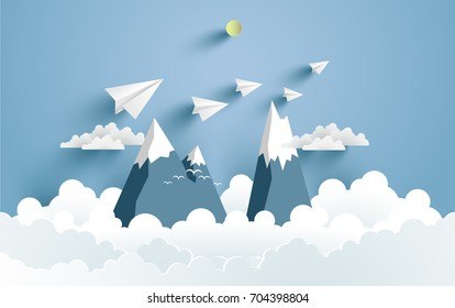 Mountains and clouds and there are paper planes on it with paper and craft art designs