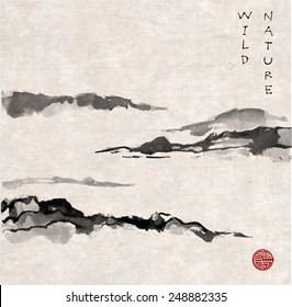 Mountains in fog hand-drawn with ink in traditional Japanese style sumi-e on vintage rice paper. Sealed with decorative stylized stamps.