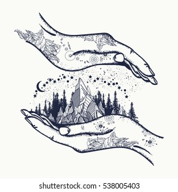 Mountains in hands, tattoo. Symbol of  travel, tourism, meditation t-shirt design, surreal graphics