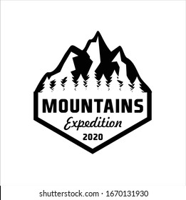 Mountains logo emblem vector illustration. Outdoor adventure expedition, mountains silhouette shirt, print stamp. Vintage typography