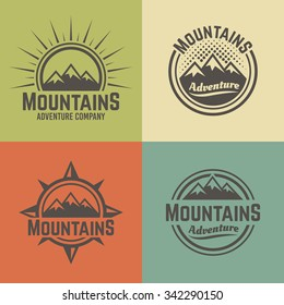 Mountains set of four vector colored vintage badges, labels, emblems and logos, hiking and climbing, travel and mountain camping