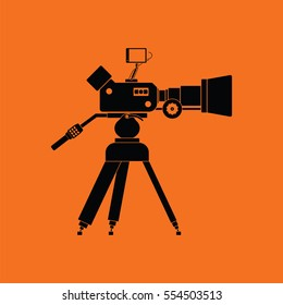Movie camera icon. Orange background with black. Vector illustration.