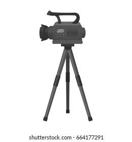 Movie camera on a tripod. Making a movie single icon in monochrome style vector symbol stock illustration web.