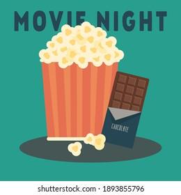 Movie night snack scene. Popcorn and chocolate.