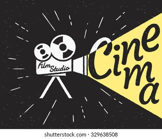 Movie projector with yellow light and cinema letters. Retro stylized illustration on black background with grunge texture