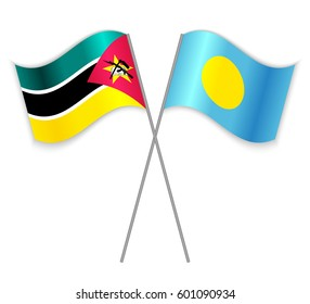 Mozambican and Palauan crossed flags. Mozambique combined with Palau isolated on white. Language learning, international business or travel concept.