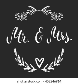 Mr and Mrs card, Vector isolated hand drawn hand lettering with floral botanical wreath. Printable wedding card black template. Modern brush pen calligraphy. Cute words and phrases. Ready-to print.