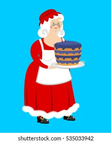Mrs. Claus and blueberry cake. Wife of Santa and dessert. Christmas woman in red dress and white apron