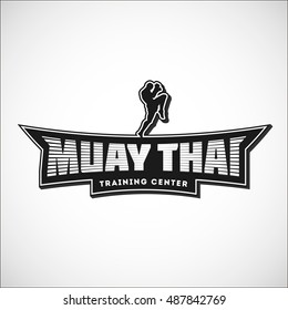 Muay Thai team logo. Training center emblem, logo, badge. Vector illustration with a fighter  for your t-shirt, gym, label, combat store and sticker design