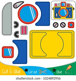Multicolored camera with a lens. Education paper game for preshool children. Vector illustration.