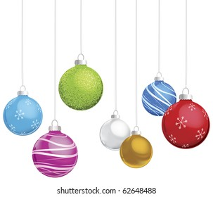 Multi-colored Christmas ornaments on white background