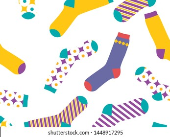 Multi-colored socks on a white background, pattern. View from above. Many different socks for cold seasons. Socks are scattered on a bright background.