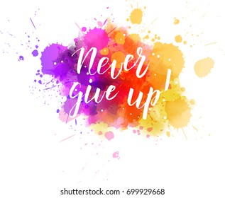 "Multicolored splash watercolor blot with handwritten modern calligraphy text ""Never give up!"""