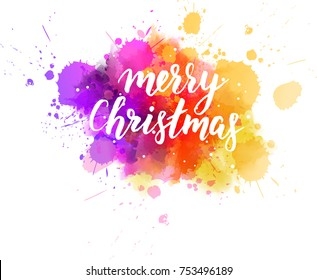 "Multicolored splash watercolor blot with handwritten modern calligraphy text ""Merry Christmas"""