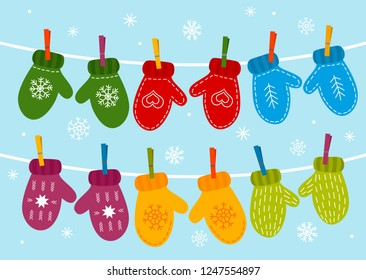 Multicolored warm mittens hang on a rope, snow falls. flat vector illustration isolated