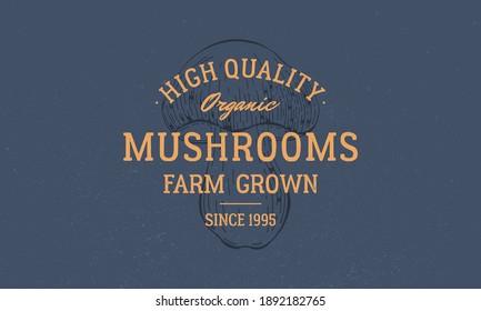 Mushrooms farm grown logo. Vintage mushroom logo, label, emblem. Mushroom on dark blue background. High quality, organic emblem for mushroom farms, food market. Vector illustration