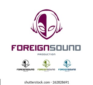 Musical logo design template. Abstract alien head shape with headphones. Vector art.