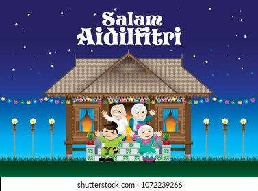 "A Muslim family celebrating Raya festival in their traditional Malay style house.  With village night's background. The white words ""Salam Aidilfitri"" means happy Hari Raya."