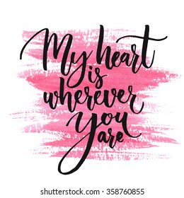My heart is wherever you are. Romantic quote for Valentines day cards and prints. Black ink calligraphy at pink watercolor texture