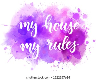 My house my rules- handwritten modern calligraphy lettering. On purple colored watercolor painted splash background.