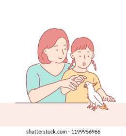 My mother and daughter are looking curiously at the pet parrot. hand drawn style vector design illustrations.