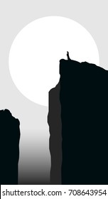 mysterious landscape with cloaked man silhouette on cliff