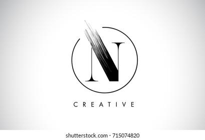 N Brush Stroke Letter Logo Design. Black Paint Logo Leters Icon with Elegant Circle Vector Design.
