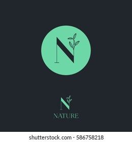 N letter.  N monogram. Nature logo for cosmetic or organic food. Green letter with leaves on a dark background.