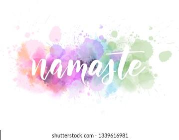Namaste (Indian greeting, Hello in Hindi) handwritten modern calligraphy lettering on watercolor imitation splash paint background. Inspirational typography.