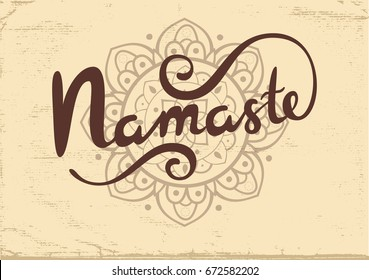 Namaste vector lettering with mandala isolated on textured beige background.