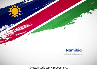 Namibia flag made in brush stroke background. National day of Namibia. Creative Namibia national country flag icon. Abstract painted grunge style brush flag background.