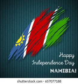 Namibia Independence Day Patriotic Design. Expressive Brush Stroke in National Flag Colors on dark striped background. Happy Independence Day Namibia Vector Greeting Card.