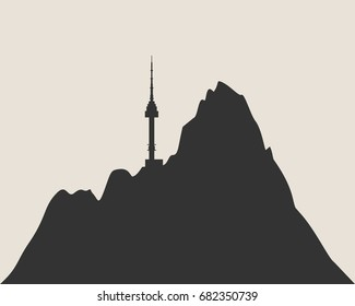 Namsan tower in Seoul icon in simple style. High mountains silhouette.