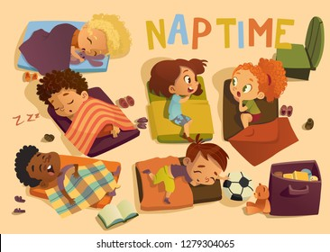 Nap time in the kindergarten. Group of multiracial girls and boys have a nip time at a colorfill nap mats. Preschool dream time. Two girls gossip during daytime sleep.