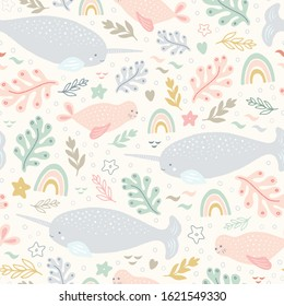 Narwhal pattern. Vector sea life seamless repeat design with rainbows.