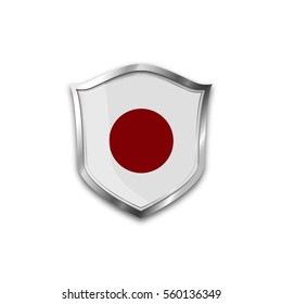 The national flag of Japan. Metal shield with reflections on a white background.