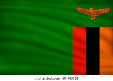 The national flag of Zambia on wavy silk background with bokeh lights. Realistic vector illustration.