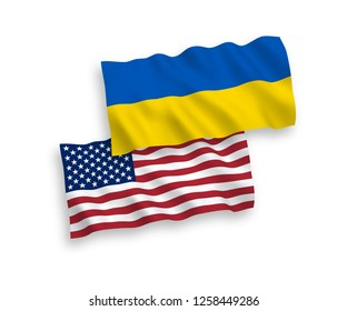National vector fabric wave flags of Ukraine and USA isolated on white background.