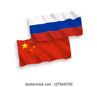 National vector fabric wave flags of Russia and China isolated on white background.