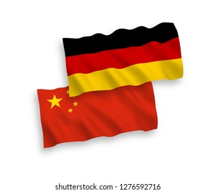 National vector fabric wave flags of Germany and China isolated on white background.